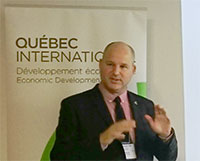 Hugo Saint-Laurent, CEO of SiliCycle, doing a presentation of the company to the guest from Québec International